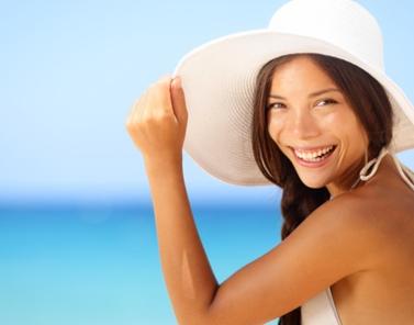 Vacation beach woman smiling happy portrait