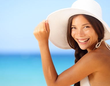 Vacation beach woman smiling happy portrait